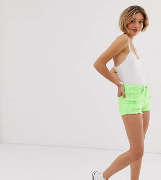 Parisian Petite distressed denim shorts in neon green