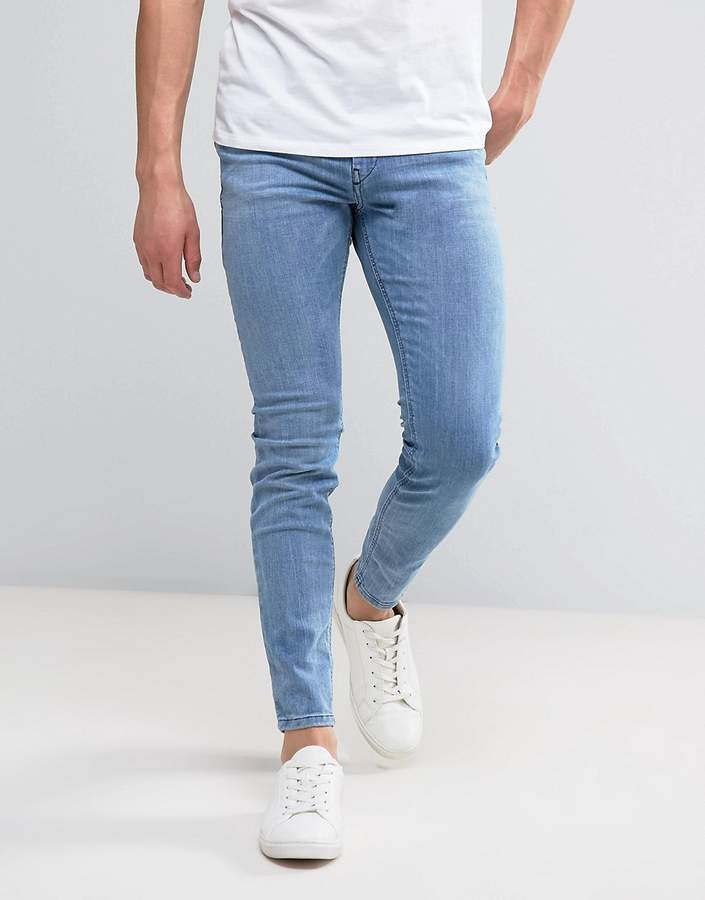 DieselDiesel Stickker Super Skinny Jeans 084DA Mid Light Wash