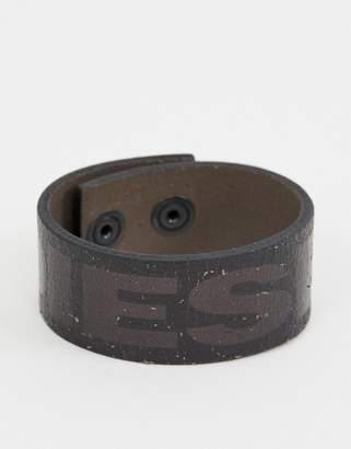 Diesel leather wrap bracelet in black with logo detail