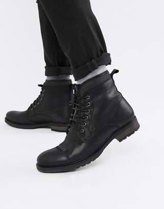 Asos Design DESIGN lace up work boots in black leather with faux shearling lining