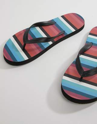 Asos DESIGN flip flops in black with stripe print