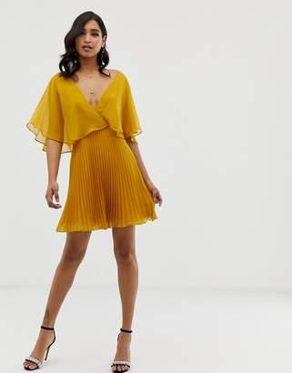 Asos Design DESIGN flutter sleeve mini dress with pleat skirt
