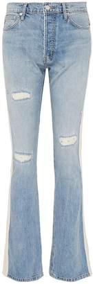 Sandrine Rose Tuxedo stripe outseam distressed flared jeans