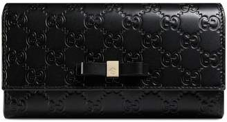 Gucci Bow Signature continental wallet