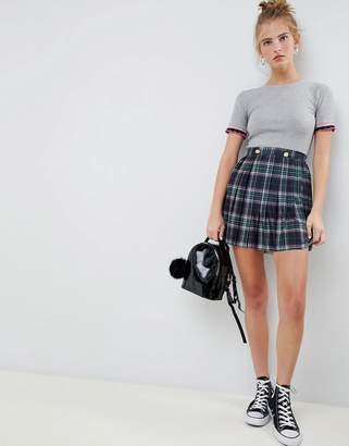 Asos Design DESIGN pleated check mini skirt with gold button trims