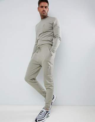 Asos DESIGN tracksuit muscle sweatshirt/ skinny joggers with MA1 pockets