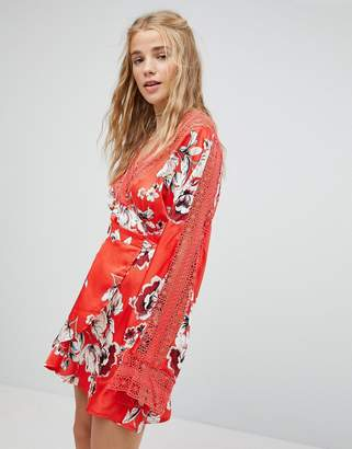 Kiss The Sky Wrap Front Tea Dress In Floral