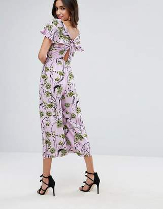 Asos DESIGN Jumpsuit with Twist back and Frill Detail in Floral Print