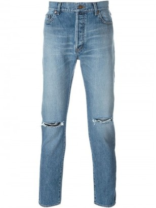 Saint Laurent slim washed jeans $750 thestylecure.com