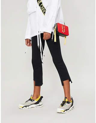 Mo&Co. Flared mid-rise stretch-denim jeans