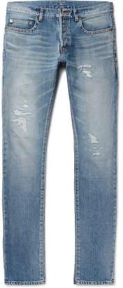 Saint Laurent Slim-Fit 17cm Hem Distressed Washed-Denim Jeans