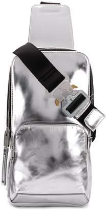 Alyx silver-toned metallic cross body backpack