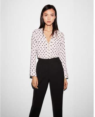 Express polka dot long sleeve zip front blouse