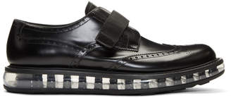 Prada Black Wingtip Strap Creeper Brogues
