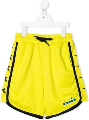 Diadora Junior contrast piping track shorts