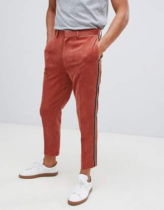 Asos DESIGN tapered PANTS in rust cord with side stripe