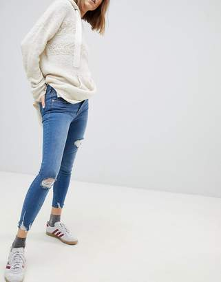 Free People Skinny Jeans With Light Distressing