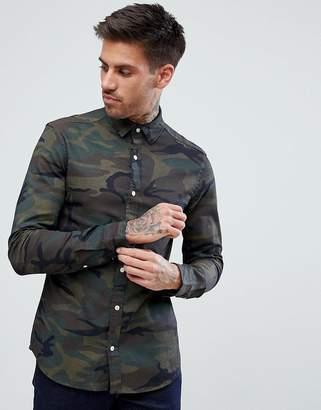 Asos Design DESIGN skinny denim shirt with camo print