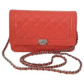 Chanel Orange Patent leather Handbag Boy