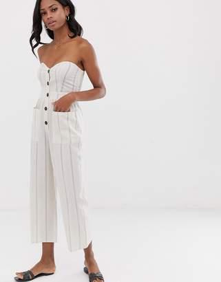Asos Design DESIGN bandeau button front jumpsuit with pockets in stripe print