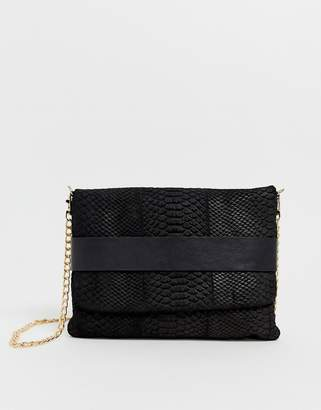 Urban Code Urbancode real leather fold over clutch bag