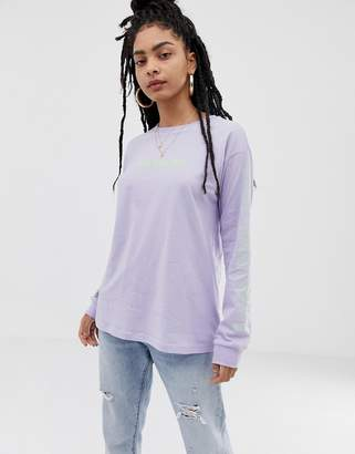 Asos DESIGN long sleeve t-shirt with stacked NYC graphic