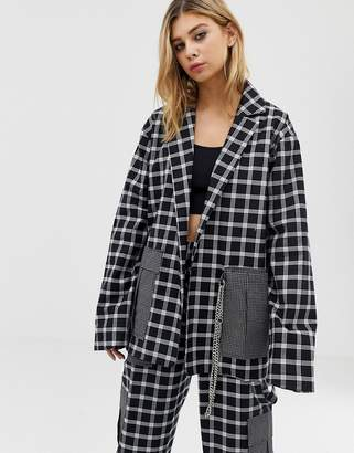 The Ragged Priest mixed check blazer with chain detail