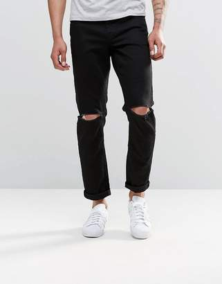 Asos Design Stretch Slim Jeans With Knee Rips In Black