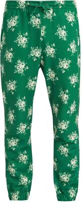 Gucci Floral-print Web-trimmed jersey track pants