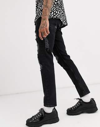 Asos Design DESIGN slim jeans in washed black with heavy rips