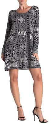 Loveappella Crisscross Strap Back Mixed Print Swing Dress