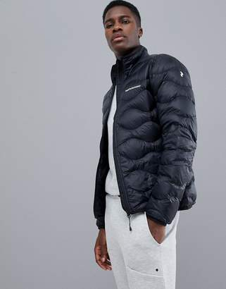 Peak Performance Helium Puffer Jacket In Black