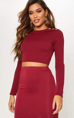 PrettyLittleThing Burgundy Button Detail Long Sleeve Crop Top