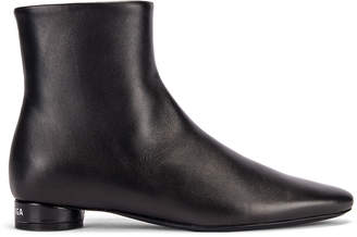 Balenciaga Oval Flat Booties in Black & White | FWRD