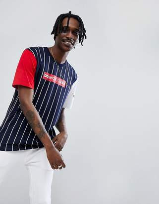 DC t-shirt in stripe with contrasting sleeves