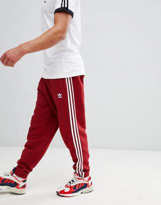 adidas adicolor 3-Stripe Joggers In Red CW2428