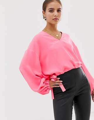 Asos Design DESIGN long sleeve v neck top with elasticated waist detail in neon