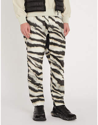 Stone Island Tiger-print shell trousers