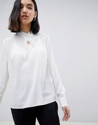 Warehouse blouse with keyhole button detail in ivory