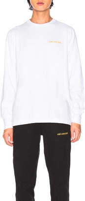 Leon Aime Dore Long Sleeve Logo Tee in White | FWRD