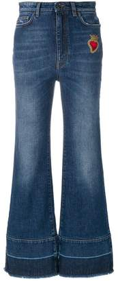 Dolce & Gabbana flared jeans with sacred heart appliqué