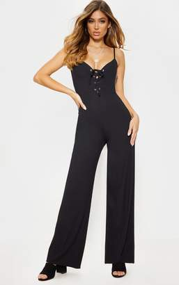 PrettyLittleThing Black Lace Up Strappy Rib Jumpsuit
