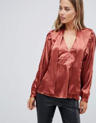 Asos Design DESIGN plunge long sleeve top in satin with pussybow detail