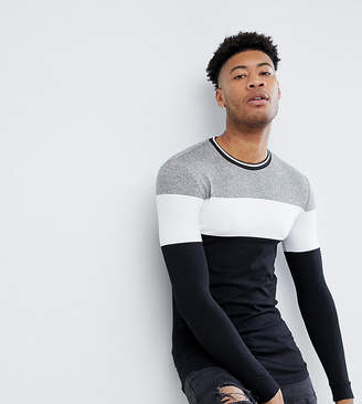 Asos DESIGN Tall muscle fit longline long sleeve t-shirt with twisted jersey yoke panel and tipping neck