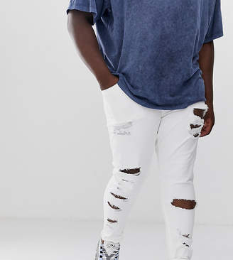 Asos Design DESIGN Plus spray on jeans in power stretch with heavy rips in white