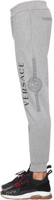 Versace Printed Logo Cotton Jersey Sweatpants