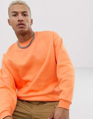 Asos Design DESIGN oversized sweatshirt in bright orange