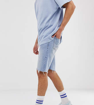Reclaimed Vintage inspired denim shorts with raw hem in blue