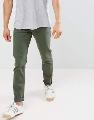 Asos DESIGN slim jeans in green