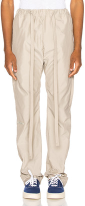 Fear Of God Baggy Nylon Pant in Bone | FWRD